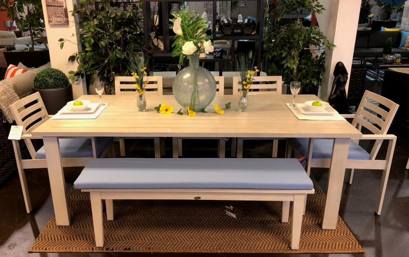 element dining set in white with bench and light blue cushions.