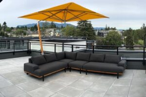 Divano lounge set with yellow overhanging umbrella.