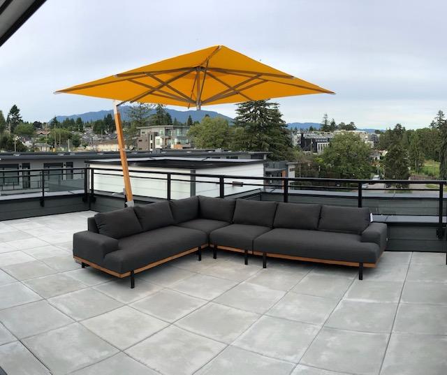 Divano lounge set with yellow overhanging umbrella.