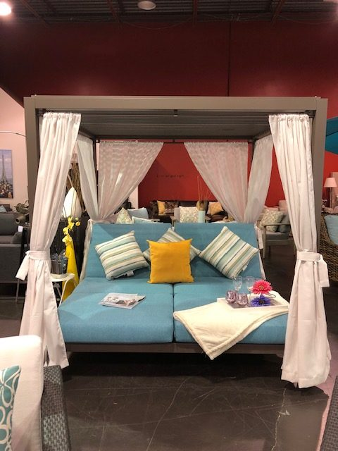 The Gianna Daybed with white curtains, blue cushions & yellow accent pillows.