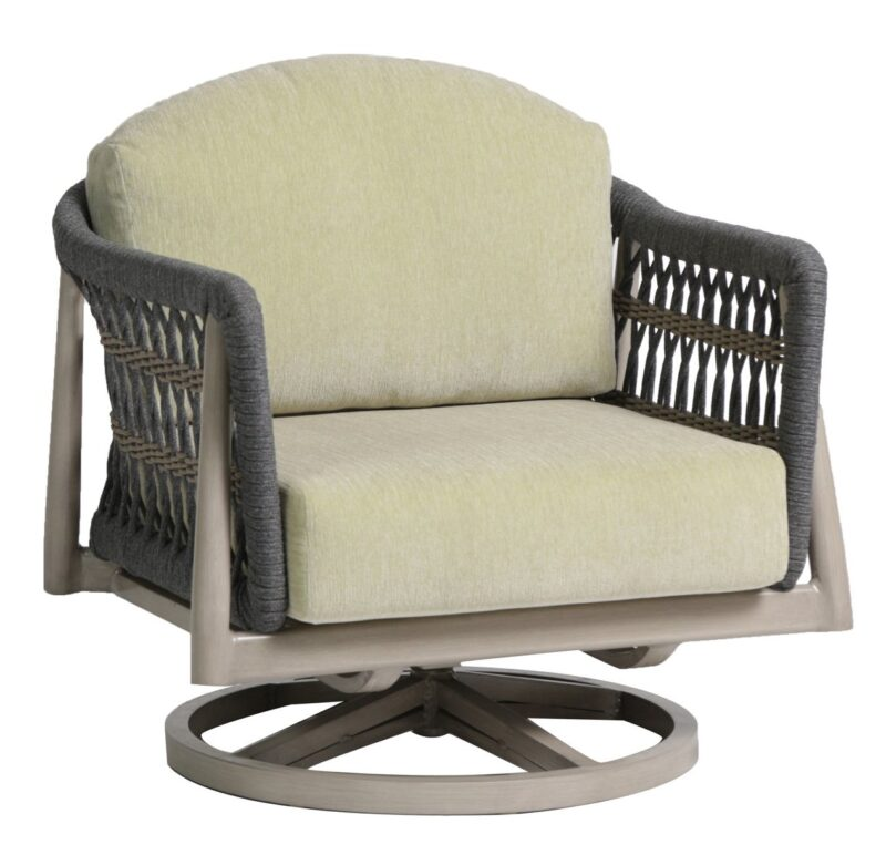 The coconut grove ratana swivel club chair with platform aloe green cushions.