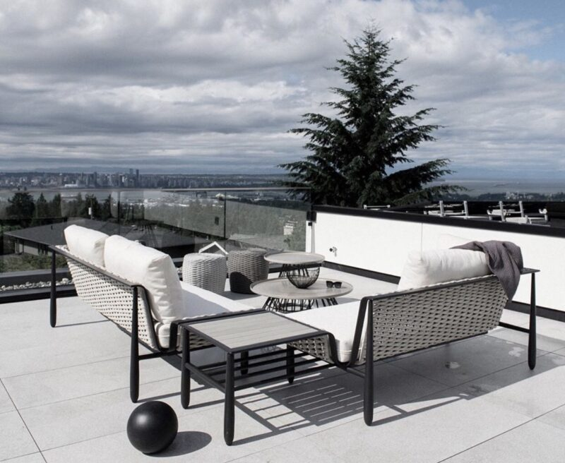 Diva by Ratana sectional on a rofftop deck with tree and a cloudy sky.