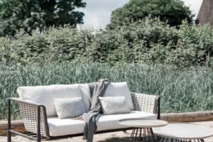 The Diva by Ratana sofa with grass in the back ground.