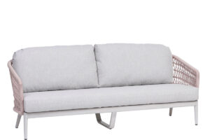 the poinciana pink collection ratana sofa with white cushions.