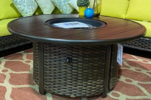 "The 48"" round fire table by Ratana in a brown finish."