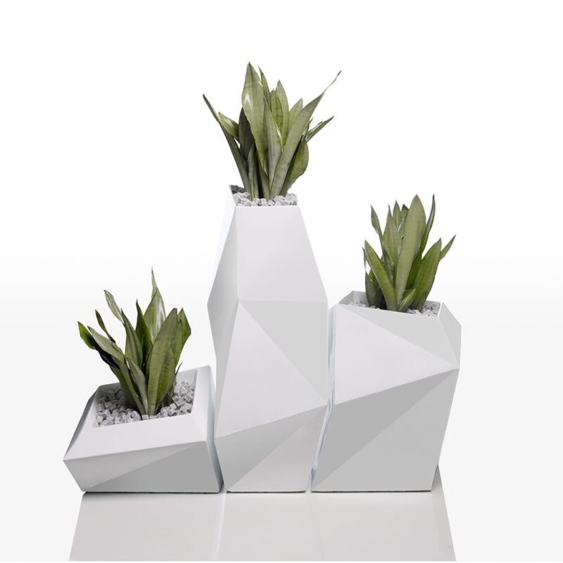 The vondom Faz planter collection in white with green plants in them.