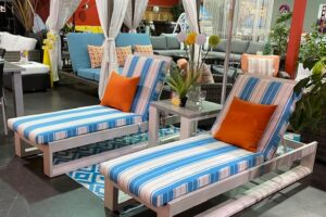 Element 5.0 loungers by Ratana with striped cushions.