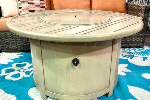 "The 42"" round gas fire table with lid on."